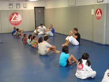 Gracie Barra instructors engage the children